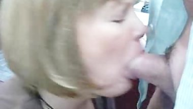 milf momor wife is giving a BJ to the boss at the office