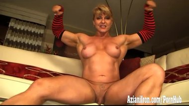 Beautiful bodybuilder strips and flexes her big strong muscles