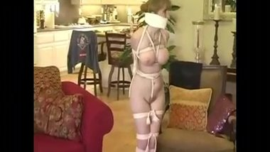 Hopping around at home, gagged and in tight rope bondage
