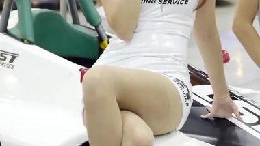 Korean race queen in too short minidress does everything to avoid upskirt !