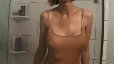 Getting wet in panties and cami to clean bathroom. Hubby films me for you.