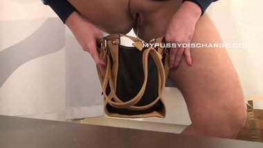 Milf peeing into a bag on sale before putting it back at the shop