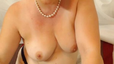 BBW MILF smokes and plays with her supple breasts