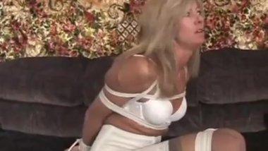Blonde milf bound and gagged in white dress