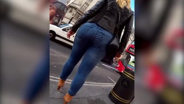 enjoy! Hidden cam spying curvy big ass blonde MILF walking in tight jeans !