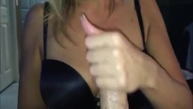 Beautiful milf who is an expert in tugging and sucking the cock