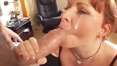 Red head milf takes a facial